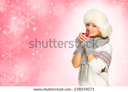 Young girl with mug on red snowy background - stock photo