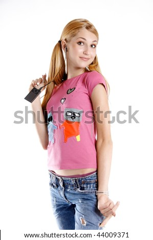 Young girl with music player and headphones - stock photo