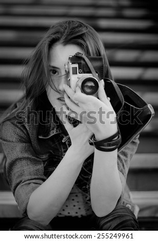 Young girl with old camera - stock photo