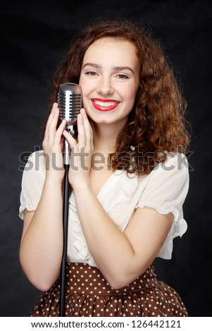 young girl with old-fashioned microphone
