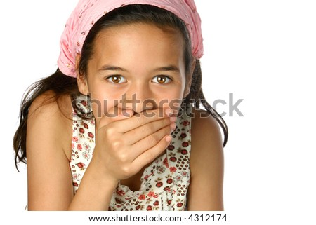 Young girl with one hand covering her mouth, isolated. - stock photo