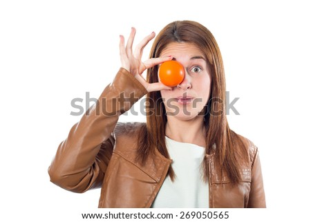 Young girl with orange ball in the eye isolated on white background - stock photo