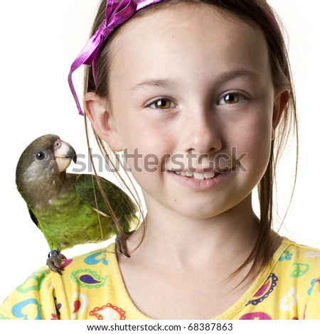 Young girl with parrot on her shoulder - stock photo