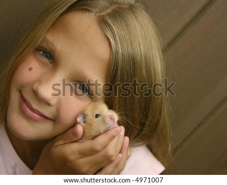 Young girl with pet hamster