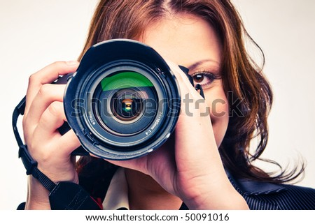 young girl with photocamera isolated on white - stock photo