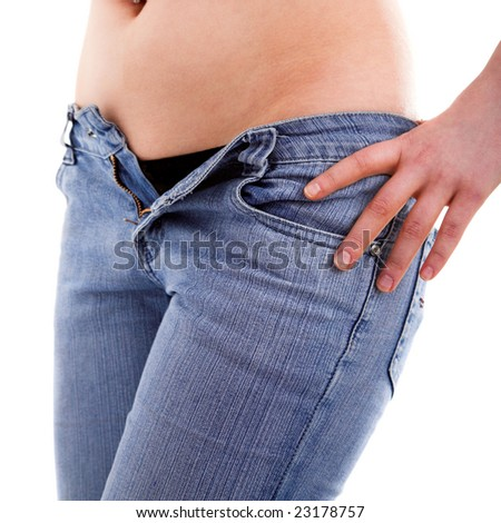 Young girl with piersing unzipping her jeans