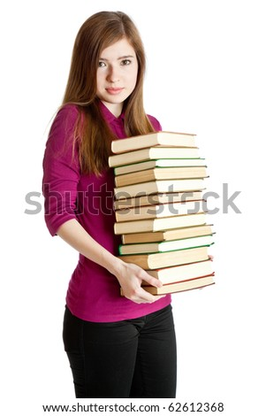 Young girl with pil? of books in hands. Isolated on white background
