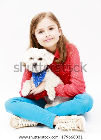 Young girl with  puppy, cute Maltese dog  - best friends - stock photo