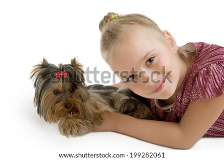 Young girl with puppy, cute Yorkshire terrier  - stock photo