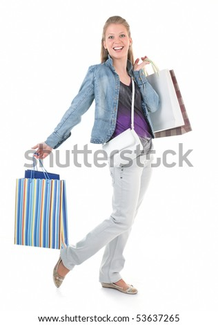 young girl with purchases on white background