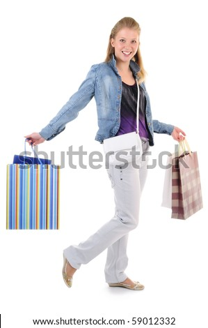 young girl with purchases on white background - stock photo