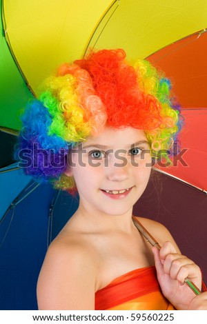 Young girl with rainbow colored wig and umbrella