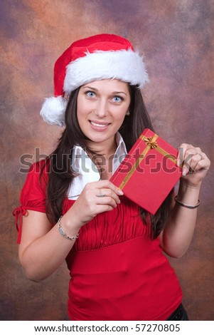 young girl with red christmas clothes and box gift - stock photo