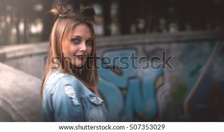young girl with red lips posing in a denim jacket