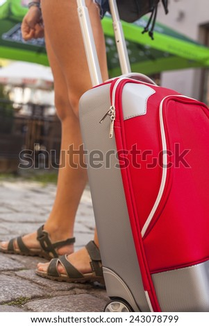 Young girl with red suitcase close-up. Travel concept. - stock photo