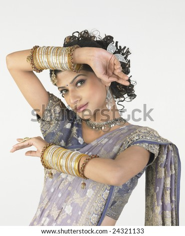 Young girl with rich bangles in nice hands expressions - stock photo