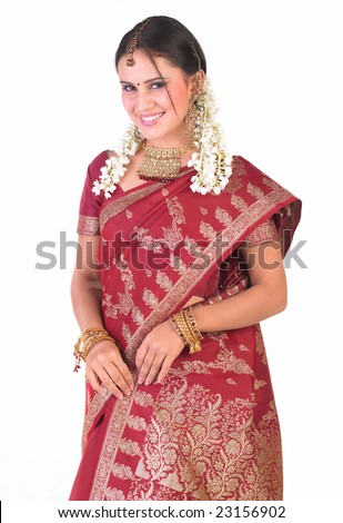 Young girl with rich red silk saree standing  happily - stock photo