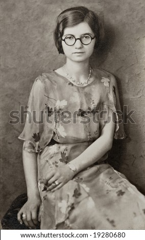 Young Girl with Round Glasses Antique Photograph - stock photo