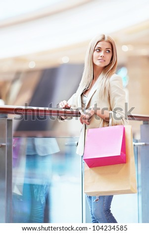 Young girl with shopping bags in shop - stock photo