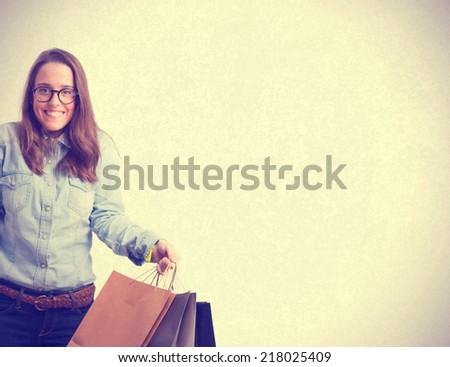 young girl with shopping bags. isolated - stock photo