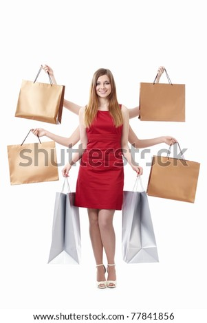 Young girl with shopping bags on white background - stock photo