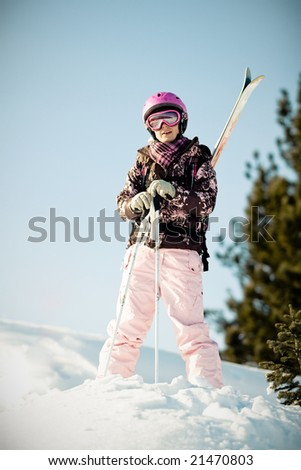 Young girl with skis on back