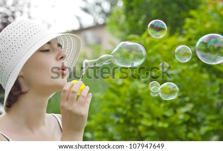 young girl with soap bubbles - stock photo