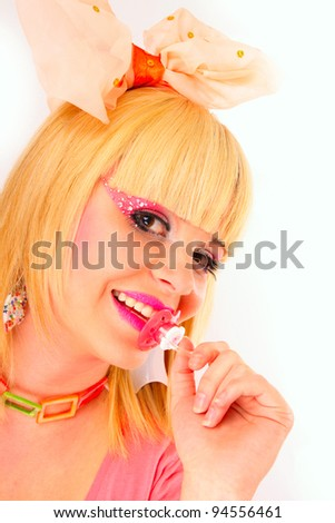 young girl with soother in the mouse