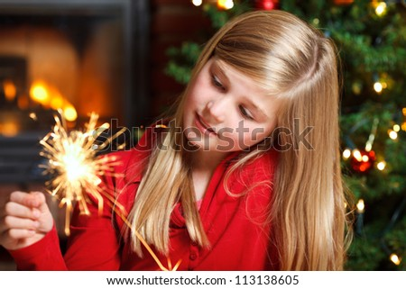 young girl with sparkler - stock photo
