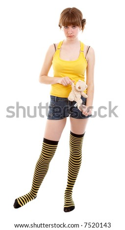 Young girl with teddy bear isolated at the white background