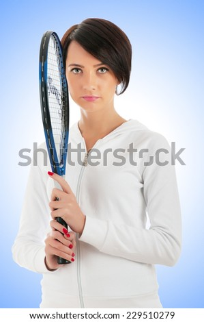 Young girl with tennis racket and ball isolated on white