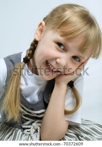 Young girl with the hand in face - stock photo