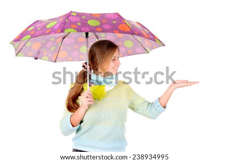 young girl with umbrella isolated in white background - stock photo