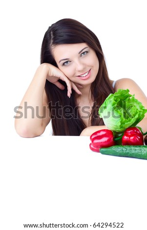 young girl with  vegetables over white background - stock photo