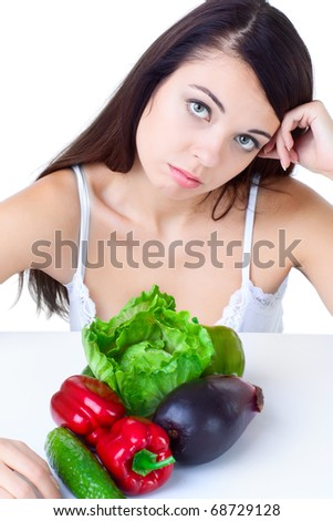young girl with  vegetables over white background