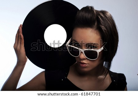 Young girl with vinyl - stock photo