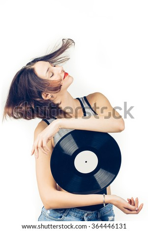 Young girl with vinyl record on white