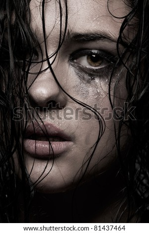 young girl with wet hair and running make up - stock photo
