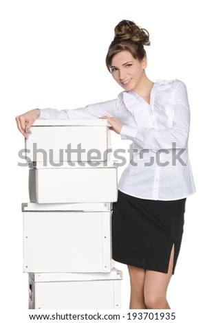 Young girl with white boxes isolated on white - stock photo