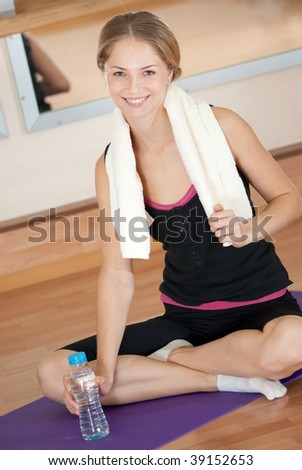 Young girl with white towel after fitness workout