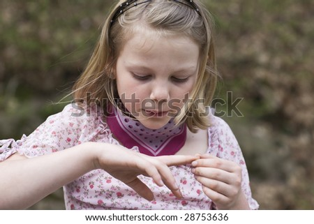 Young girl with wound finger - stock photo