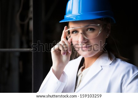 young girl worker in the factory - stock photo