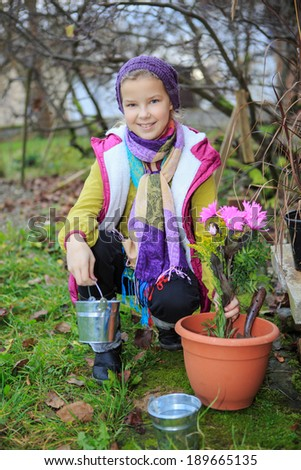 young girl working in the garden - stock photo