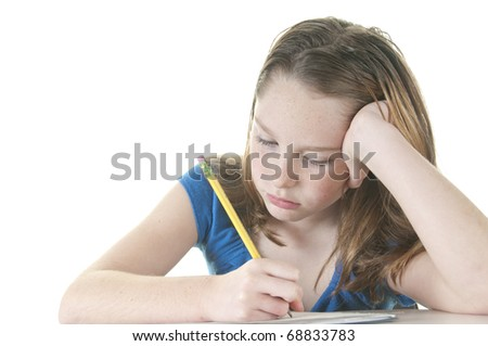Young girl working on school work looking bored - stock photo