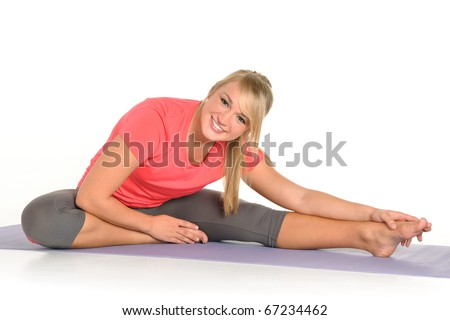 Young girl working out and stretching - stock photo