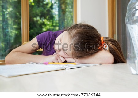 Young girl works on her notes and dozes off - stock photo