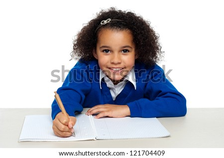 Young girl writing copying notes from the whiteboard. Isolated against white background. - stock photo