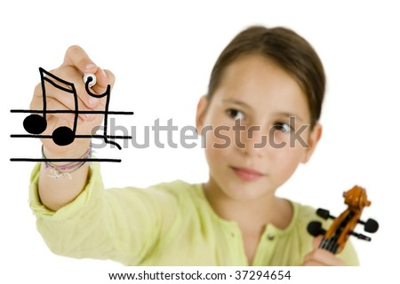 young girl writing with a pen and holding a violin isolated on white background - stock photo