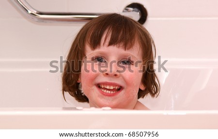 Young girl (4Yr) happy in bath - stock photo