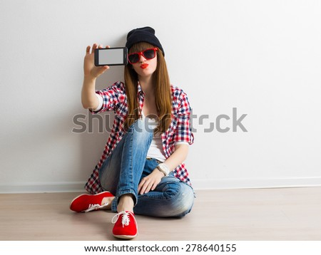 young girlfriend in sunglasses with smartphone in hands make selfie, having fun. Modern Lifestyle - stock photo
